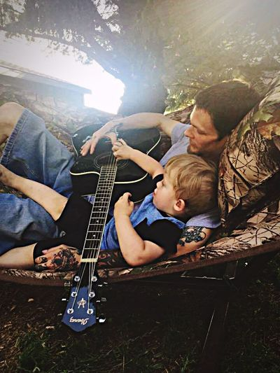 Playing guitar Music Playing Guitar Arts Culture And Entertainment Togetherness Two People Musical Instrument Sunlight Men Musician People Skill  Adult Outdoors Day Rock Music
