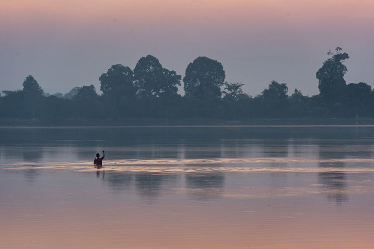 Angkor ASIA Cambodia Cultures Dawn Fisherman Fishing Lake Landscape Nature One Person Outdoors Reflection Sky Srah Srang Sunrise_sunsets_aroundworld Travel Destinations Village Life Water