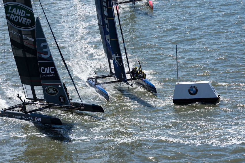 Land Rover BAR and Artemis closing in on the mark. The British Team Land Rover BAR (LBAR) with helmsman Ben Ainslie and the Swedish Team Artemis (ARTR) with helmsman Nathan Outteridge are closing in on a mark close to Lower Manhattan in the second race on May 8, 2016, on the Hudson River in New York, NY. The Louis Vuitton America's Cup World Series races were held in May 2016 in New York City, after a break of 96 years. The boats are AC45F catamarans with hydrofoiling daggerboards, rigid wings, and five man crew. Aquatic Sport Competition Competitive Sport Day Extreme Sports Leisure Activity Men Nautical Vessel Outdoors People Real People Sport Sports Race Swimming Pool Water Catamaran America's Cup Sailracing Sailing Boat Hudson River Sailing Vessel Sail Race Race Ship Sailing Ship