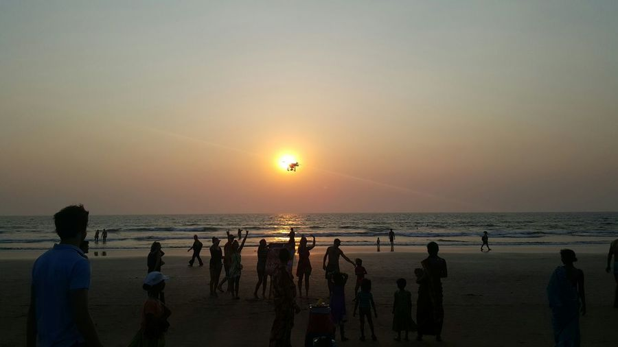 Sea Sunset Beach Outdoors Water Horizon Over Water People Beauty In Nature Travel Destinations Sun Nature Scenics Large Group Of People Sand Adults Only Adult Togetherness Young Adult Human Body Part Day Drone  Drone Moments Goa India Arambol Beach