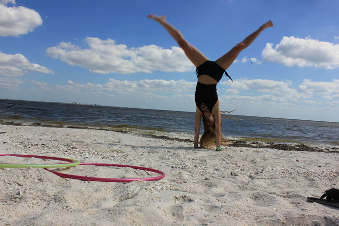 The Week On EyeEm Lost In The Landscape Cartwheel Cartwheels Handstand  Yoga Yogi Girl Doing Cartwheel Beach Yoga Beach Cartwheel Beach Florida Beauty Florida Life Florida Beaches SantibelnIsland, Florida Vacationer Travel Happy Girl Yoga Girl Carefree In Florida Second Acts Inner Power Visual Creativity Summer Exploratorium Focus On The Story #FREIHEITBERLIN The Portraitist - 2018 EyeEm Awards The Traveler - 2018 EyeEm Awards