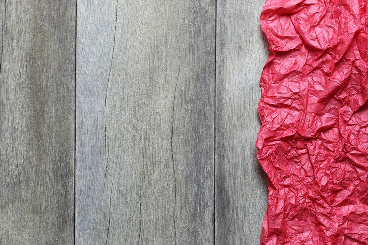 Red art paper of crumpled on brown wooden floor background and have copy space to design in your work Christmas concept. Backgrounds Red Close-up Textured  No People Pattern Full Frame Indoors  Gray Directly Above Copy Space Still Life Food And Drink Freshness Food Material Textile Creativity Day Textured Effect Red Art Paper Art Paper Crumpled Crumpled Paper Background