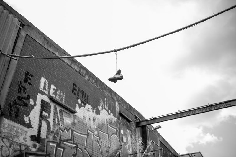 Outdoors Low Angle View City Sky Architecture No People City Life City Street New York New York City New York City Streets Schuh Schuhe❤ Schuhe In Der Sonne Schuhladen Graffiti Blackandwhite Black And White Black And White Photography Black&white Your Ticket To Europe