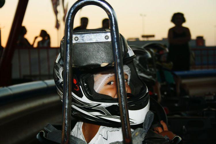 Portrait Of Boy In Helmet While Karting