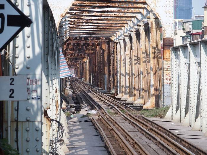 Rusty railroad tracks at railway bridge