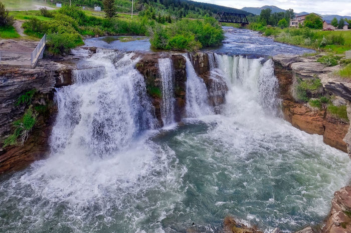 Waterfalls at Lundbreck in Canada. Alberta Grass Lundbreck Falls Trees Beauty In Nature Bridge Building Canada Day Mountains Nature No People Outdoors Power In Nature River Rocks Scenics Water Waterfalls