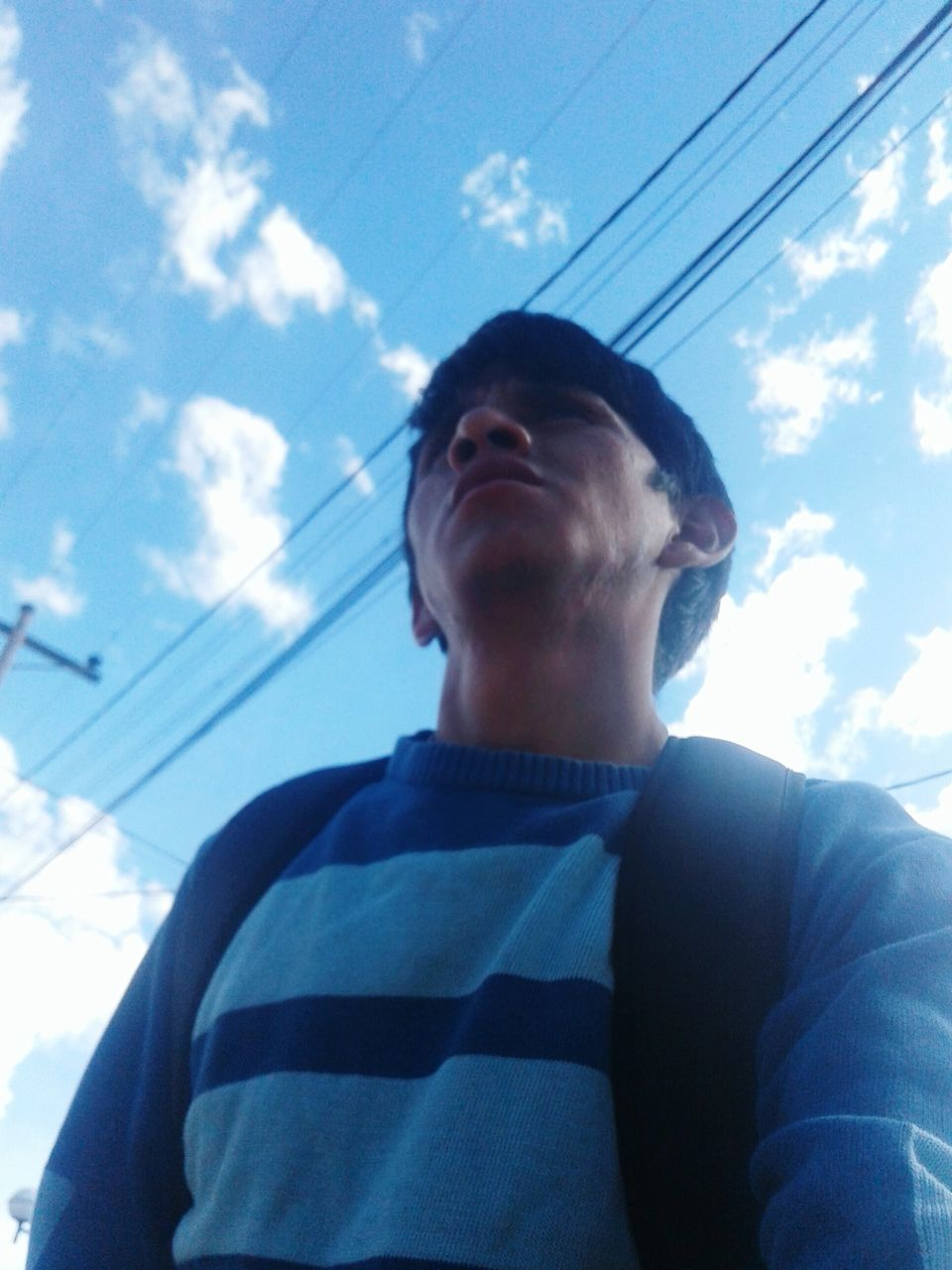 sky, low angle view, cloud - sky, real people, one person, cable, day, outdoors, young adult, nature