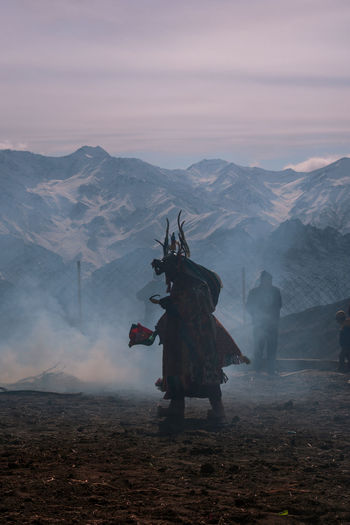 mask dance Winterinladakh Buddhist Mask Dance Mask Dance Action Moment Dance Culture And Tradition Mood Cham Dance Liker Fog Adult Adults Only Outdoors Night People Mountain One Person Sky Only Men One Man Only