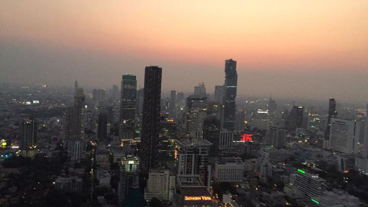 cityscape, skyscraper, city, architecture, building exterior, sunset, illuminated, travel destinations, urban skyline, city life, no people, downtown district, modern, outdoors, sky, day
