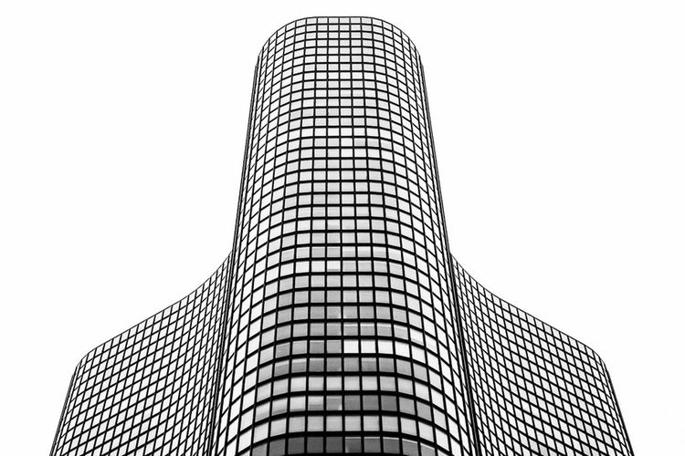 Curves in the Sky - The graceful curves of Lake Pointe Tower rise into the overcast Chicago sky. Chicago Architecture Black & White Urban Geometry
