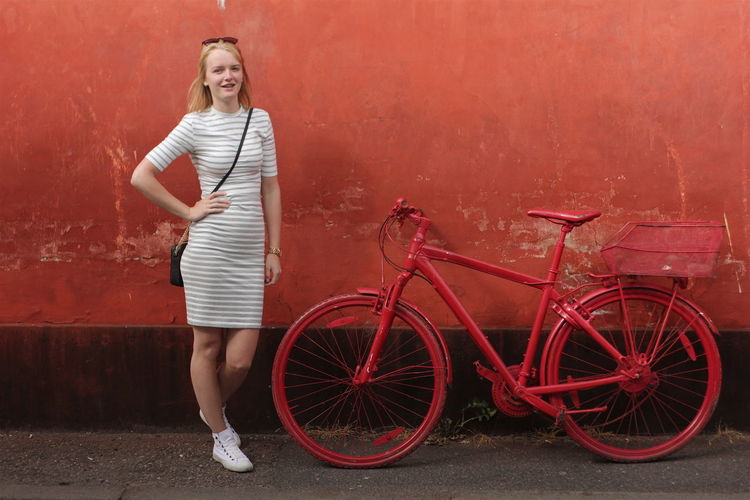 Color Contrast Dress Full Length Girl Hanging Out Model Parked Parked Bicycle Playing Around Portrait Posing Red Bicycle Red Bicycles Red Color Unusual Bicycle Wall White Dress