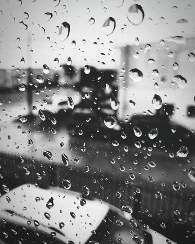Glass - Material Window Drop Transparent Water Weather Close-up Rain No People Wet Backgrounds Rainy Season Full Frame Day Indoors  Land Vehicle RainDrop Nature Sky Passenger Boarding Bridge