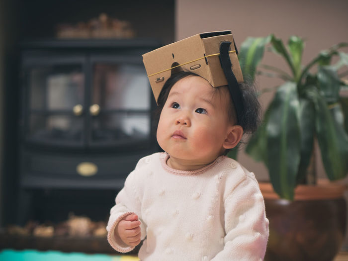 baby girl wearing VR goggles Asian Baby Girl Baby Baby Girl Babyhood Childhood Close-up Cute Day Focus On Foreground Front View Goggles Indoors  Innocence Looking Up One Person Portrait Real People Toy Visual Reality