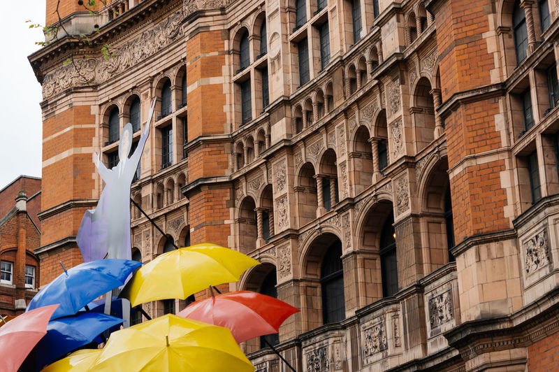 Colorful umbrellas in front of an old building