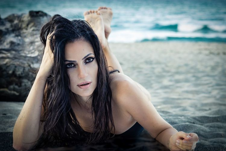 EyeEm Selects Beauty Beautiful People Beach Water One Woman Only Sea Summer Sand Portrait Beautiful Woman Nice Lips Nice Face Long Hair Woman Eyes Cat Fashion Model Nature Background Fashion Photography On The Beach Make Up Artist Make Up Make Up Brushes Outdoors Black Hair Long Hair