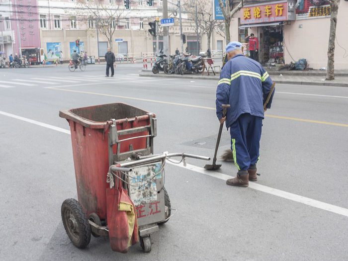 Casual Clothing China City Life Full Length Land Vehicle Leisure Activity Lifestyles Men Mode Of Transport Morning Occupation Real People Rear View Selective Focus Shanghai Sitting Street Togetherness Transportation Urban Walking Women