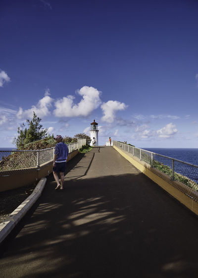 Hawaii Kauai Lighthouse Woman Built Structure Cloud - Sky Day Full Length Horizon Over Water Land Leisure Activity Lifestyles Nature Outdoors People Real People Rear View Road Sea Shadow Sky Sunlight The Way Forward Water