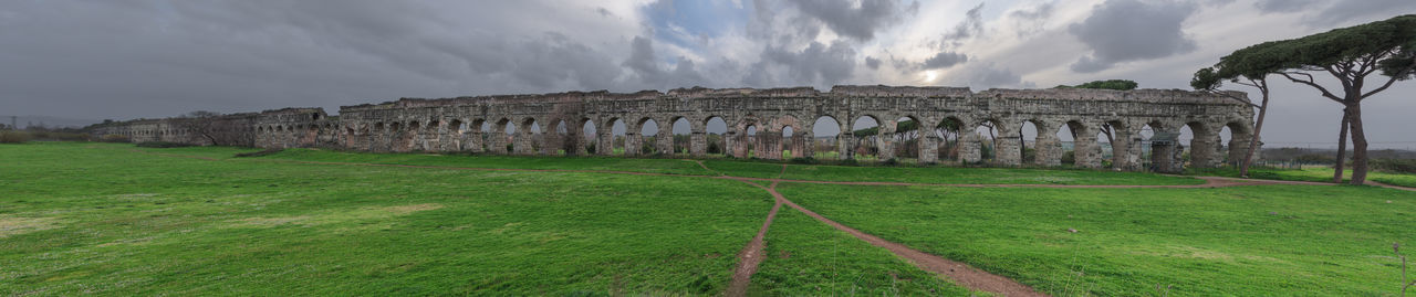 View of old ruin building against cloudy sky
