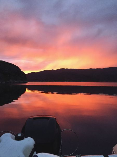 Sunset Sunset Silhouettes Sunset #sun #clouds #skylovers #sky #nature #beautifulinnature #naturalbeauty #photography #landscape Sailing Water Reflection Orange Color Beauty In Nature Wonderfuld Greenland