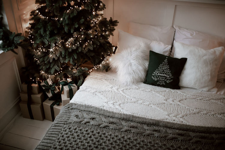Christmas tree on bed at home