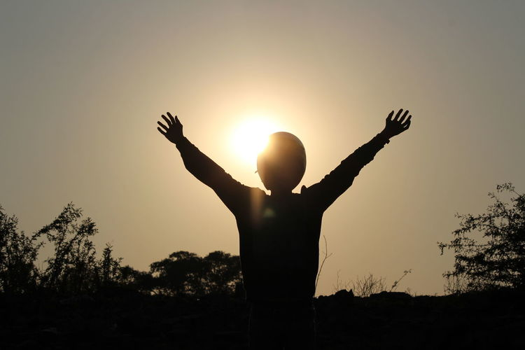 sunset Human Arm Limb Human Body Part Arms Raised Sunset People One Person Happiness Outdoors Spirituality