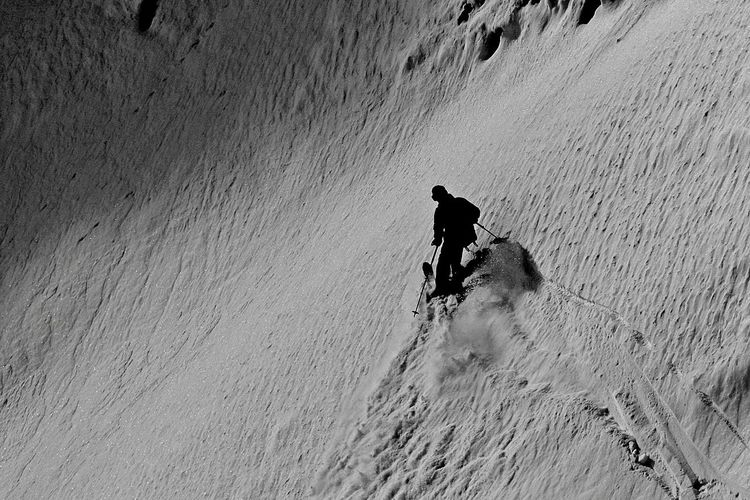 High angle view of man on snowcapped mountain
