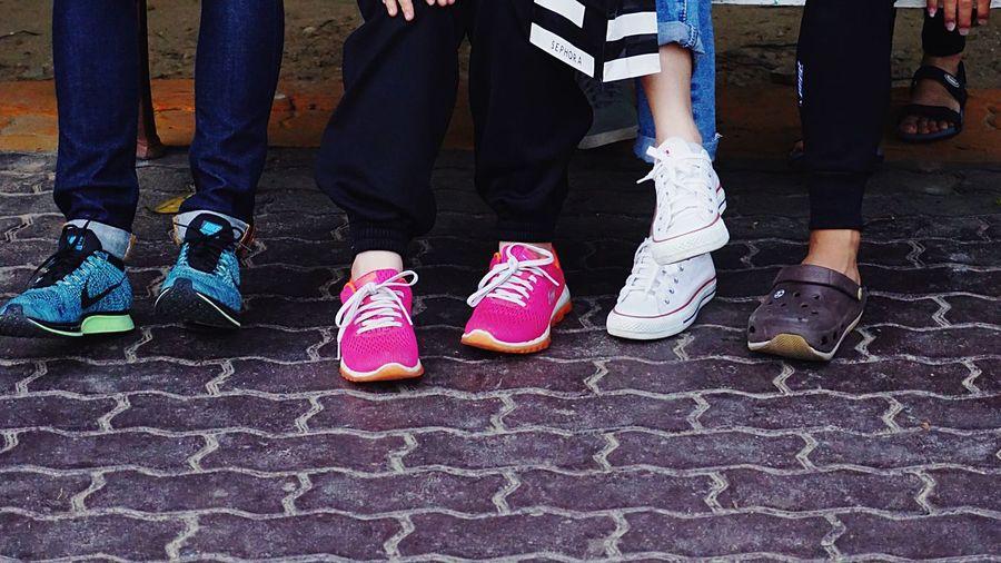 Step Real People Sitting Nike Shoe Outdoors Low Section Human Leg Men Lifestyles Women Human Body Part Friend