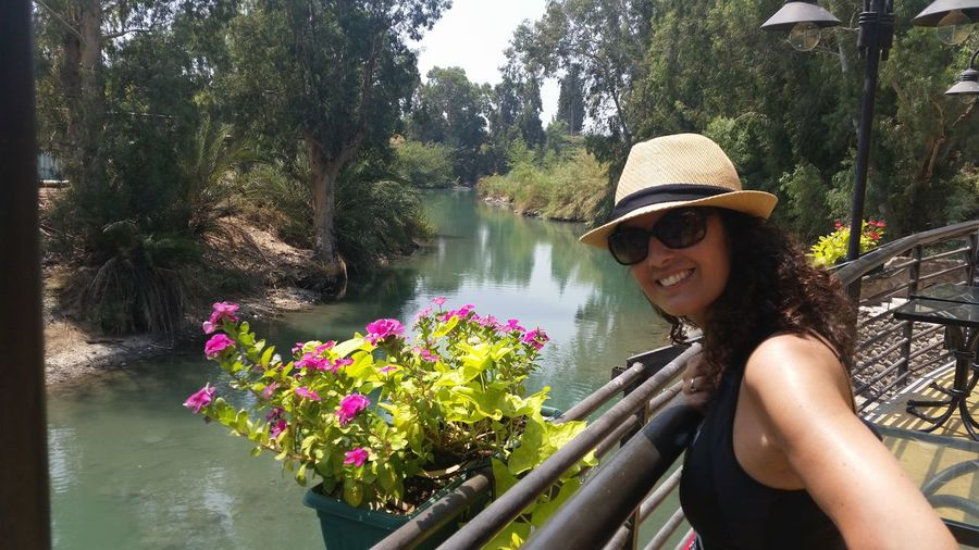 baptismal site Jordan river Yardenit River Jordan Israel Plant One Person Smiling Leisure Activity Young Women Water Real People Young Adult Lifestyles Nature Flowering Plant Portrait Tree Women Day Beauty In Nature Flower Happiness Growth Glasses Fashion Outdoors Hairstyle
