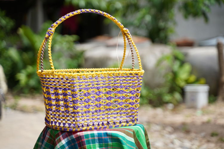 Close-up of multi colored wicker basket