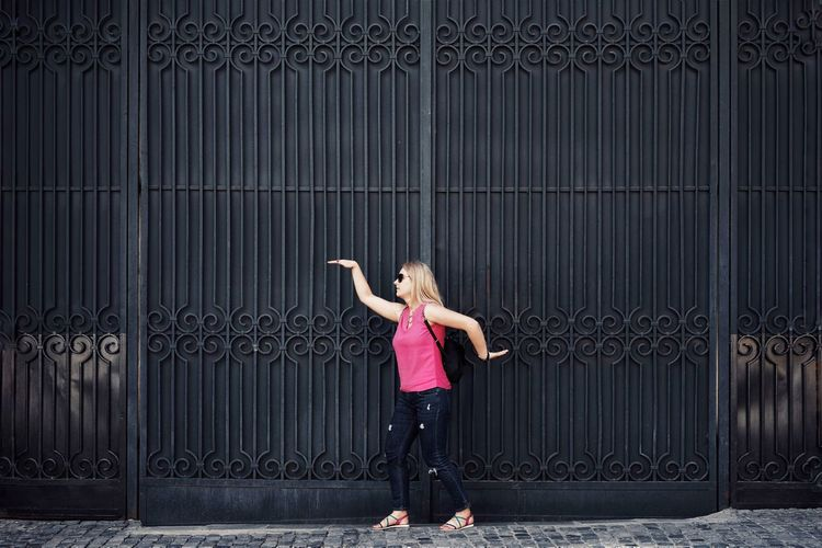 Fence High Fence Wall Metallic Architecture People Pattern One Person One Woman Only Women One Young Woman Only Full Length Young Women Fashion Arms Raised Women Copy Space Human Arm Ballet Tiptoe