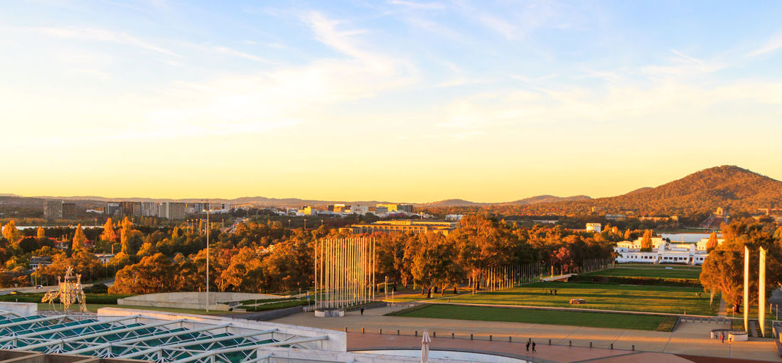 Looking from the top of Parliament House towards Canberra and the Australian War Memorial during red and orange autumn colours Autumn War Memorial Architecture Beauty In Nature Building Exterior Built Structure Day Dusk House Landscape Mountain Mountain Range Nature No People Outdoors Parliament Scenics Sky Tranquil Scene Tranquility