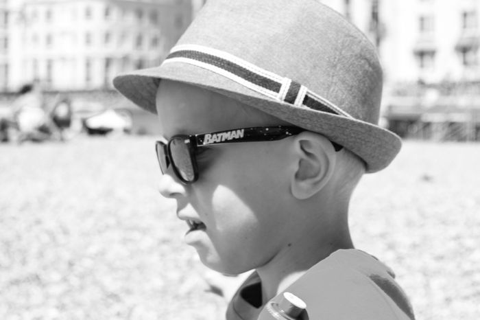 Real People Childhood Sunglasses Focus On Foreground Boys Day Outdoors Headshot One Person Close-up Elementary Age Side View Eyeglasses  Lifestyles Cap People