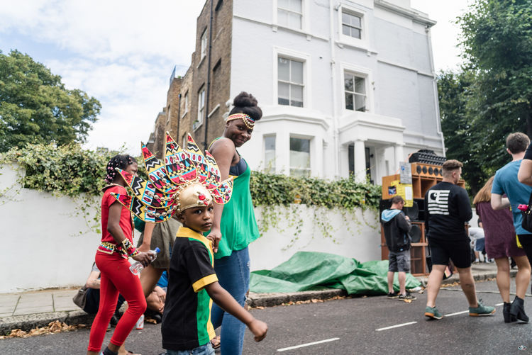 Notting Hill Carnival 2016 Architecture Building Exterior Built Structure Casual Clothing Day Enjoyment Full Length Men Outdoors Person Side View Sky Togetherness Young Adult Young Women