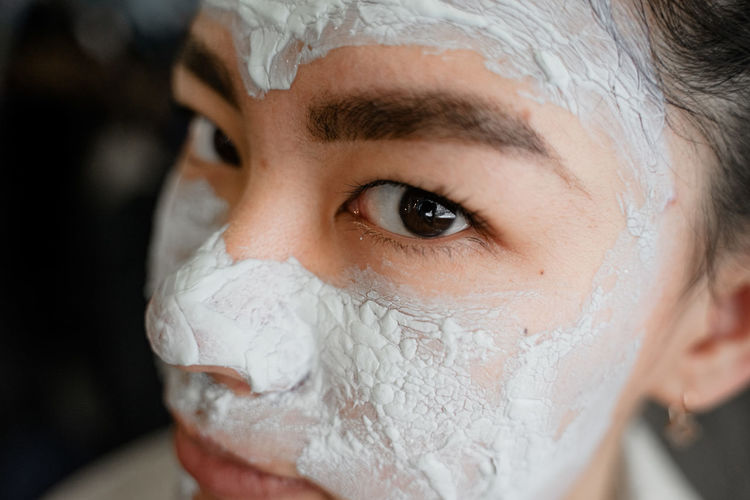 Close-up portrait of woman with facial mask