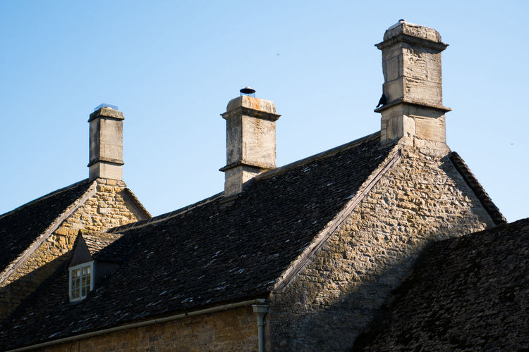 Architecture Blue Sky Building Exterior Built Structure Chimney Chimneys Clear Sky Cotswold Cotswold Stone Cotswolds Cottage Day English English Countryside Light And Shadow Roof Shadows Sky Stone Sunlight