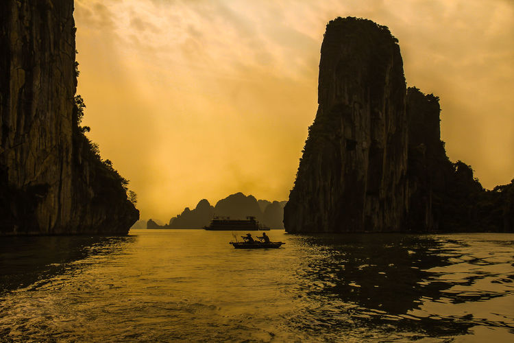 Sunset in Halong Bay Halong Bay  Halong Bay Vietnam Halong Bay Cruise Vietnam Water Sky Nautical Vessel Sunset Transportation Beauty In Nature Sea Scenics - Nature Waterfront Mode Of Transportation Nature Rock Tranquility Mountain Rock Formation Tranquil Scene Idyllic Cloud - Sky Orange Color No People Outdoors Stack Rock