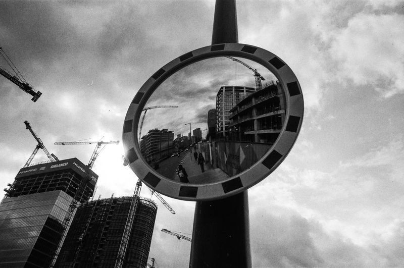 Analog; Nikon FM2 / Ilford PAN 100 The Art Of Street Photography The Week on EyeEm Capture The Moment Everyday Life Nikonphotography Analogue Photography Film Photography Grain Ilford Light And Shadow Warsaw Built Structure Architecture Building Exterior Sky Cloud - Sky Reflection City Building Day Nature Low Angle View Modern Outdoors Shape Circle Geometric Shape Glass - Material Office Building Exterior Mirror Skyscraper