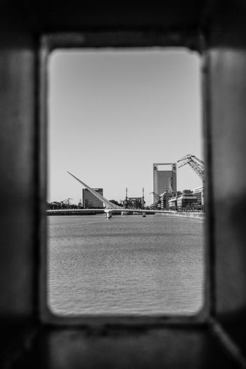 Looking through Architecture Architecture_collection Buenos Aires Cityscape Architecture Architecture_bw Bnw Bnw Photography Bridge Bridge - Man Made Structure Bridge View Bridgeporn Buenosaires Building Exterior Built Structure cityscapes Industry River Selective Focus Sky Streetphoto_bw Streetphotography Transportation Water Waterfront The Photojournalist - 2018 EyeEm Awards The Architect - 2018 EyeEm Awards The Street Photographer - 2018 EyeEm Awards