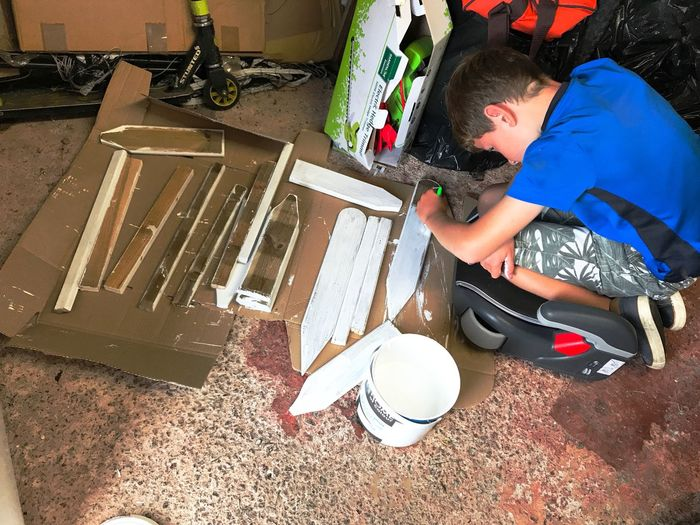 Making things Family Time One Person The Week On EyeEm Painting #Creating Making Wedding Signs Getting My Son Involved Togetherness Craft Enjoyment Painting Wood In The Garage DIY Boy