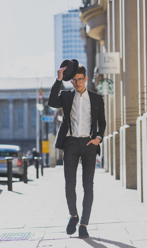 Man dressed smart with hat and glasses in city. Adult Adults Only Blazer Braces Business Business Finance And Industry Businessman City City City Life Fashion Fashion Photography Glasses Hat Jacket One Person Only Men People Shirt Smart Stylish Suit Walking Watch Young Adult The Portraitist - 2017 EyeEm Awards Stories From The City The Modern Professional
