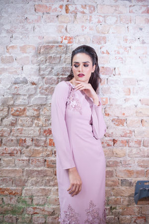 Beautiful caucasian female model wearing asian dress. Asian Culture Attractive Female Fashion Morocco Arabic Girl Arabic Style Attractive Beautiful Woman Beauty Brick Wall Caucasian Fashion Fashion Photography Lifestyles Looking At Camera Make Over People Pink Color Portrait Standing Young Women