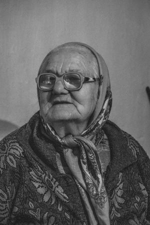 """""""In Exile"""" is a documentary portrait series of Molokans. Molokans are a Spiritual Christian religious group of Russian origin rejected more than two hundred years ago by Orthodox Church and exiled in the country of Georgia. They live in the east part of Georgia in the village of Ulianovka. After the collapse of the Soviet Union, many of them came back to Russia; also, their young generation left there to find a better job and lifestyle opportunity in the other parts of Georgia, and just a few of them(around 10 families) still live in this small territory. A small and old community which will be forgotten forever. Documentary Storytelling Blackandwhite Monochrome Real People Real Person Photography Village Places Travel Daily Life Georgia person Life Style Female Journalism Photojournalism Journalism Black And White Black & White Aged Grandma Life Christianity Belief Portrait Eyeglasses  Human Face Men Front View The Photojournalist - 2018 EyeEm Awards The Portraitist - 2018 EyeEm Awards The Traveler - 2018 EyeEm Awards"""
