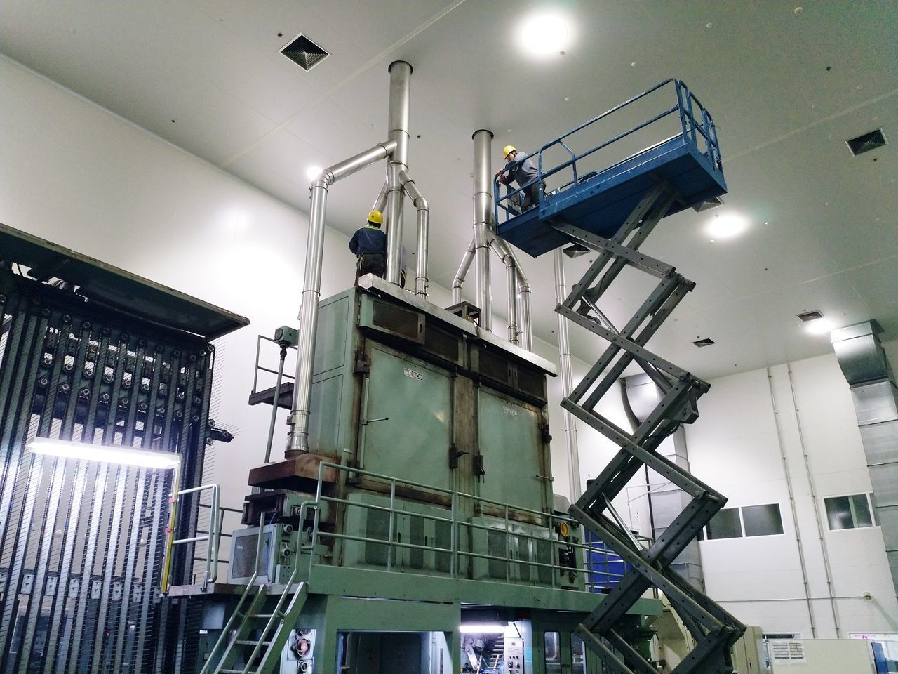 LOW ANGLE VIEW OF ILLUMINATED LIGHTING EQUIPMENT IN FACTORY
