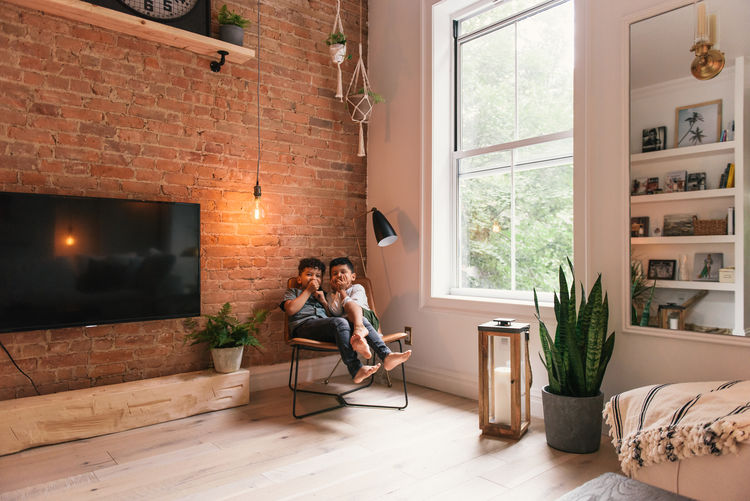 Couple sitting on floor at home