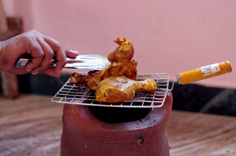 Chicken Masala Smoking Barbecue Grill Chicken Leg Chicken Tandoori Close-up Day Focus On Foreground Food Food Photography Food Preparation Freshness Holding Human Body Part Human Finger Human Hand Indulgence Meat One Person Outdoors Preparation  Ready-to-eat Food Stories