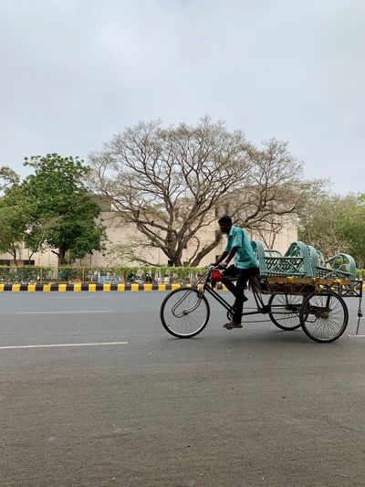 Man at work Transportation Mode Of Transportation Real People Bicycle Tree Sky Plant City Road Land Vehicle One Person Street Ride Riding Full Length Day Nature Men Lifestyles Outdoors