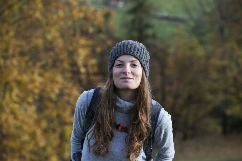 Young Adult One Person Knit Hat Long Hair Front View Portrait Young Women Clothing Hair Autumn Hairstyle Hat Leisure Activity Tree Standing Day Lifestyles Beautiful Woman Change Warm Clothing Outdoors Fall