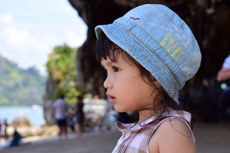 Close-Up Of Girl Wearing Hat While Looking Away