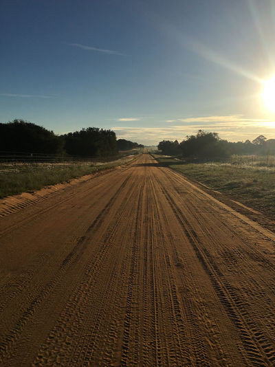 Clay road at dawn Agriculture Beauty In Nature Day Field Landscape Nature No People Outdoors Plowed Field Rural Scene Scenics Sky Sunlight Tire Track