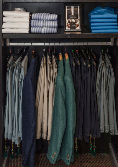 Fashion Suit Arrangement Choice Classy Clothes Rack Clothing Coathanger Dress Fashion Furniture Hanging In A Row Indoors  Jeans Large Group Of Objects No People Order Rack Retail  Retail Display Side By Side Store Textile Variation